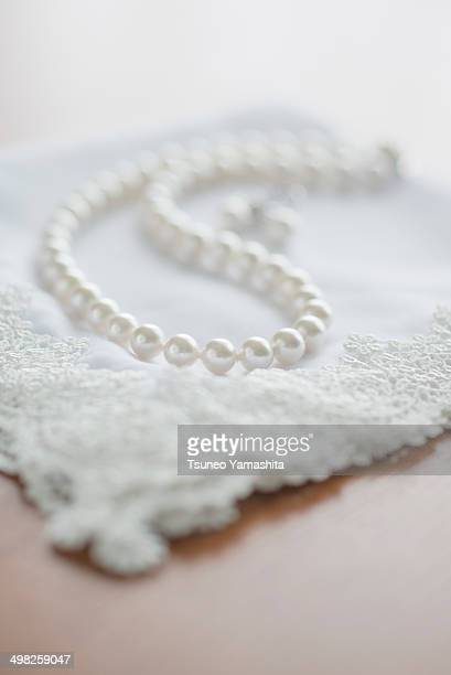 The pearl necklace on a desk