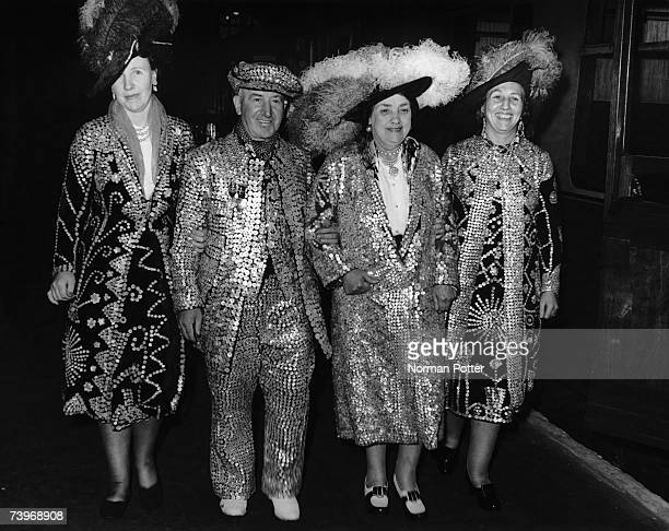 The Pearly King and Queen of Hampstead, Bert and Becky Matthews, with their daughters Rose and Elsie at Liverpool Street station where they are...