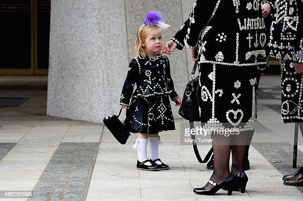 The Pearly Princess of Woolwich is greeted by Pearly Queens during the 17th Pearly Kings and Queen's Harvest Festival at The Guildhall on September...