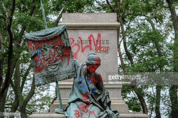 The pedestal where the statue of Confederate general Albert Pike remains empty after it was toppled by protesters at Judiciary square in Washington...