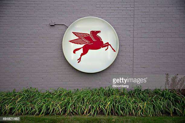 The pegasus horse logo is displayed at an Exxon Mobil Corp gas station in Cherry Valley Illinois US on Wednesday Oct 28 2015 Exxon Mobil Corp is...