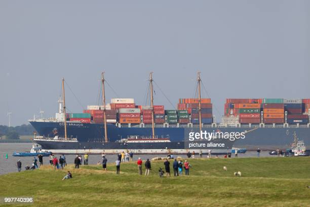 The 'Peking' museum ship and the container ship CCNI Arauco meet along the Elbe where it meets the Stor river near Wewelsfleth Germany 02 August 2017...