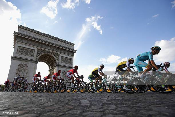 The pelaton pass The Arc de Triomphe during stage twenty one of the 2016 Le Tour de France, from Chantilly to Paris Champs-Elysees on July 24, 2016...