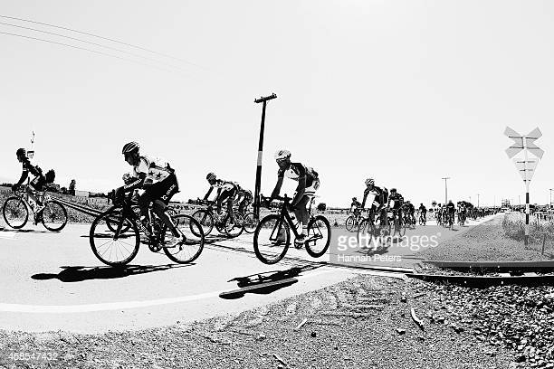 The peleton cross over a railway line on their way to Lumsden during stage 5 of the Tour of Southland on November 7 2014 in Invercargill New Zealand
