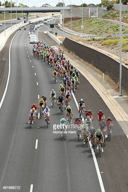 The peleton rides along the Southern Expressway during Stage 4 of the 2015 Santos Tour Down Under on January 23, 2015 in Adelaide, Australia.