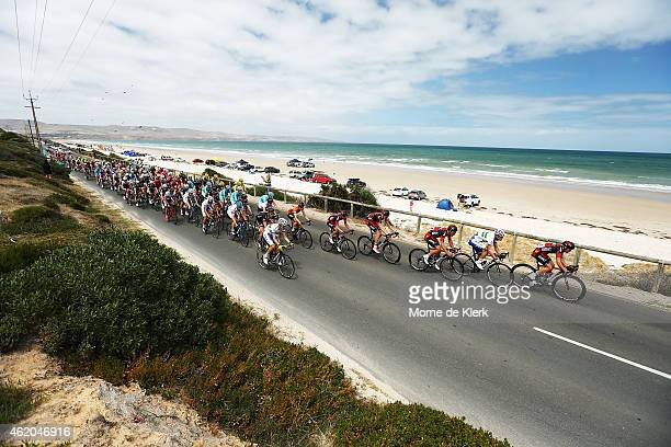 The peleton rides past Aldinga Beach during Stage 5 of the 2015 Santos Tour Down Under on January 24 2015 in Adelaide Australia