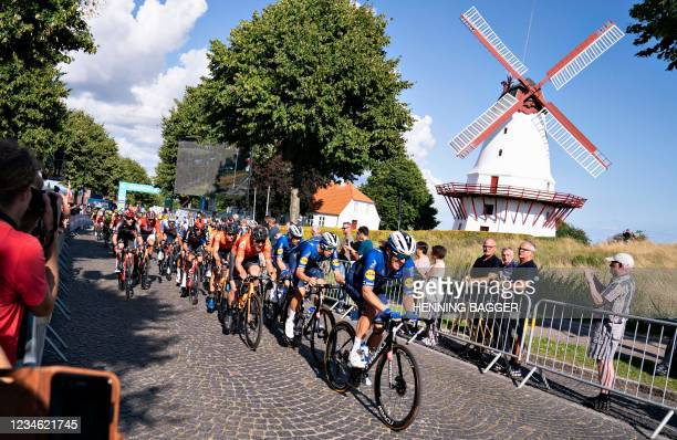The peleton rides past Dybboel Mill during the second stage of the PostNord Danmark Rundt - Tour of Denmark 6 km from Ribe to Soenderborg, Jutland,...