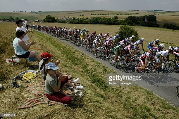 The peleton rides through the french country side during stage 2 between La FerteSousJouarre and Sedan during the Tour de France on July 7 2003 in...