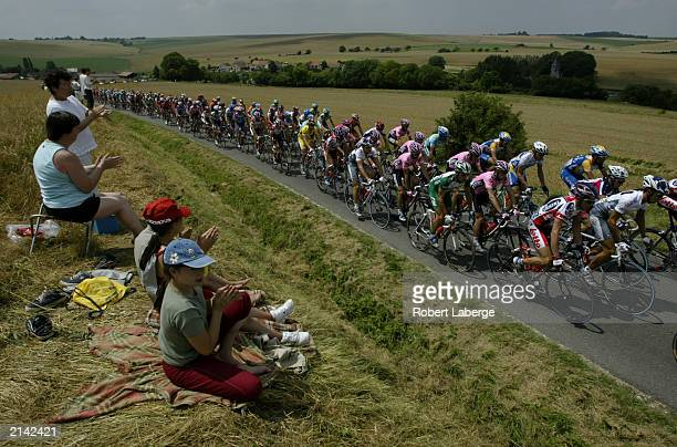 The peleton rides through the french country side during stage two between La FerteSousJouarre and Sedan during the Tour de France on July 7 2003 in...