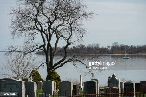 The Pelham Cemetery on City Island and Hart Island in Long Island Sound are viewed on April 7, 2020 in New York. - Hart Island has been the location...