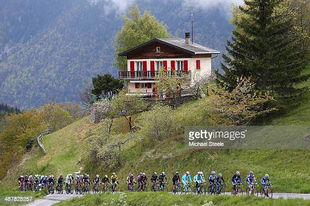 The peloton begins the first main climb during stage three of the Tour de Romandie from Le Bouveret to Aigle on May 2 2014 in Aigle Switzerland