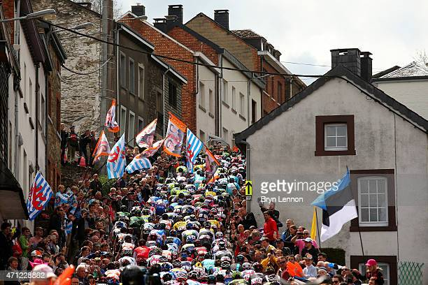 The Peloton climb through the town of Houffalize during the 101st LiegeBastogneLiege cycle road race on April 26 2015 in Liege Belgium