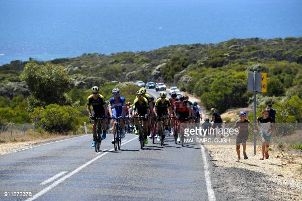 The peloton climbs out of Bells beach during the Cadel Evans Great Ocean Road cycling race in Geelong on January 28 2018 / AFP PHOTO / Mal Fairclough...