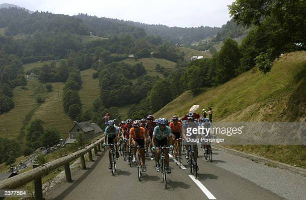 The peloton climbs the Col de Mente during stage 14 of the Tour de France from Saint Girons to Loundenvielle-Le Louron on July 20, 2003 in France.