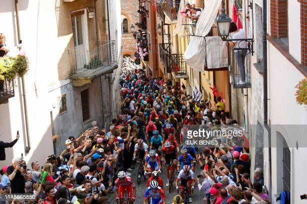 TOPSHOT The peloton climbs the wall of San Mauricio in the town of Pinerolo during stage twelve of the 102nd Giro d'Italia Tour of Italy cycle race...