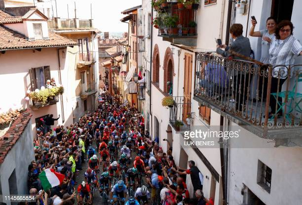 The peloton climbs the wall of San Mauricio in the town of Pinerolo during stage twelve of the 102nd Giro d'Italia - Tour of Italy - cycle race,...