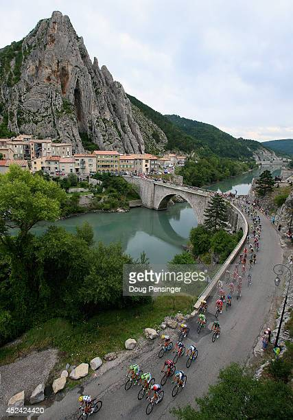 The peloton crosses La Durance River during the fifteenth stage of the 2014 Tour de France, a 222km stage between Tallard and Nimes, on July 20, 2014...