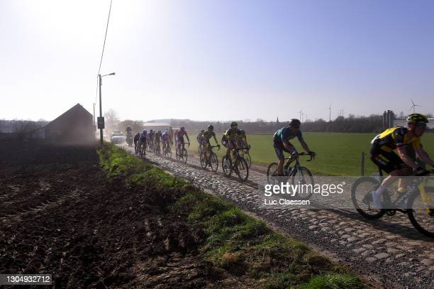 The Peloton crossing a cobblestones sector during the 53rd Grand Prix Le Samyn 2021, Men's Elite a 205,4km race from Quaregnon to Dour / Landscape /...