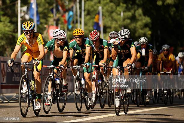 The Peloton cycle down the start/finish straight in the Men's Road Race during day seven of the Delhi 2010 Commonwealth Games on October 10 2010 in...