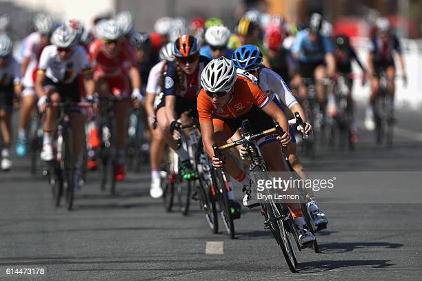 The Peloton cycle past in The Women Juniors Road Race on Day Six of the UCI Road World Championships at The Pearl on October 14 2016 in Doha Qatar