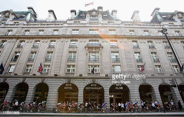 The peloton cycles past the Ritz Hotel during the Prudential RideLondonSurrey Classic on August 4 2013 in London England