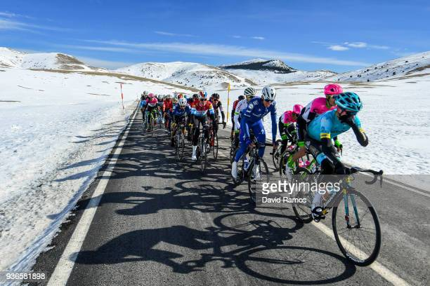 The Peloton descend by the snow the Port de la Creueta during the 98th Volta Ciclista a Catalunya 2018 Stage 4 a 1708km stage from LlanarsVall De...