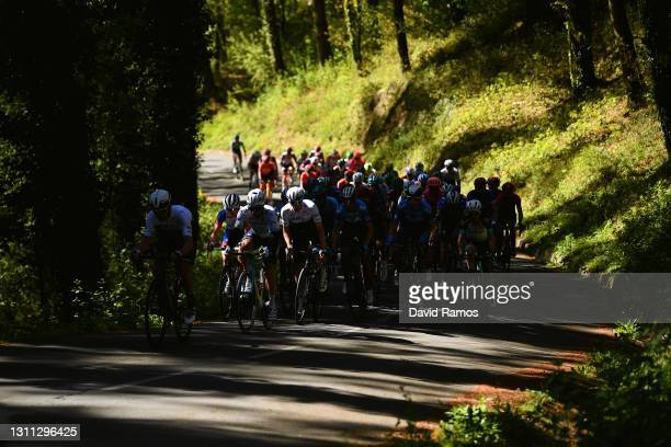 The peloton during the 60th Itzulia-Vuelta Ciclista Pais Vasco 2021, Stage 3 a 167,7km stage from Amurrio to Ermualde - Laudio 481m / Forest / Shadow...