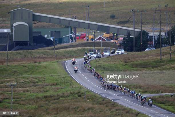 The peloton head past an open cast mine above the town of Merthyr Tydfil during stage five of the Tour of Britain from Machynlleth to Caerphilly on...