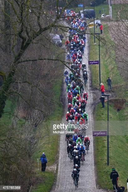 The peloton head through the cobbled lanes of Haaghoek during the Omloop Het Nieuwsblad on March 1, 2014 in Ghent, Belgium.