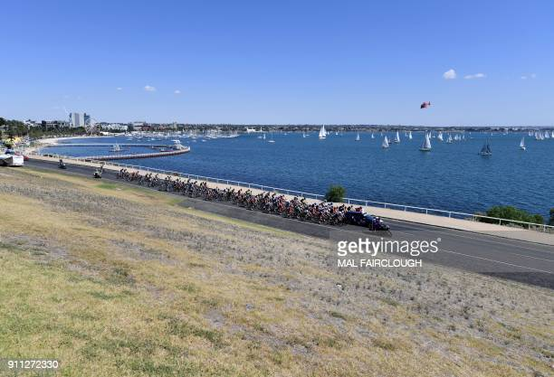 The peloton heads out of Geelong at the start of the Cadel Evans Great Ocean Road cycling race in Geelong on January 28 2018 / AFP PHOTO / Mal...