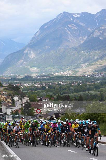 The peloton heads out of Sion on a second category climb during stage one of the Tour de Romandie from Ascona to Sion on April 30 2014 in Sion...