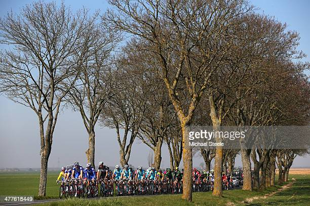 The peloton heads through the countryside during Stage Two of the Paris Nice race from Rambouillet to SaintGeorgessurBaulche on March 10 2014 in...