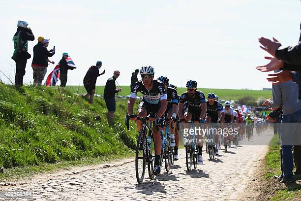 The peloton hit the first secteur of cobbles during the 2015 Paris Roubaix cycle race from Compiegne to Roubaix on April 12 2015 in Trois Ville France