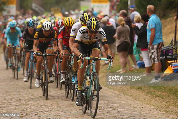 The peloton hits the cobbles on stage four of the 2015 Tour de France a 223km stage between Seraing and Cambrai on July 7 2015 in Cambrai France