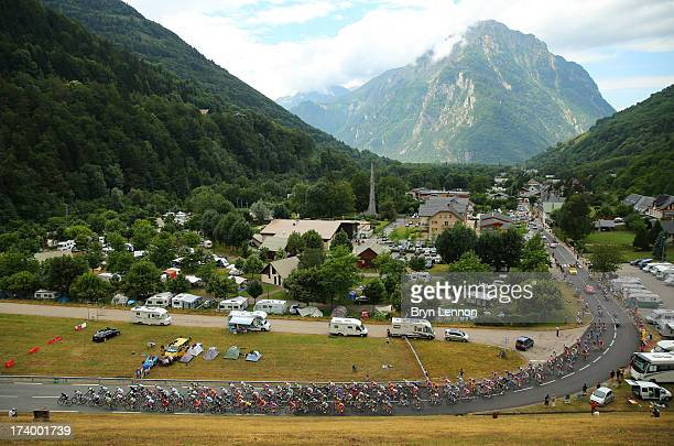 The peloton in action during stage nineteen of the 2013 Tour de France a 2045KM road stage from Bourg d'Oisans to Le Grand Bornand on July 19 2013 in...