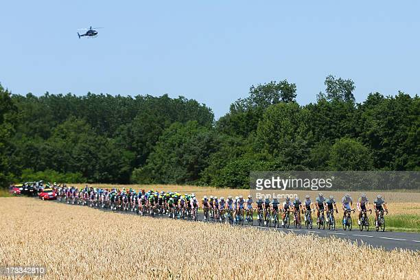 The peloton in action during stage thirteen of the 2013 Tour de France, a 173KM road stage from Tours to Saint-Amand-Montrond on July 12, 2013 in...