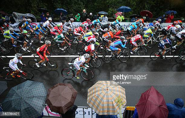 The peloton in action during the Elite Men's Road Race a 272km race from Lucca to Florence on September 29 2013 in Florence Italy