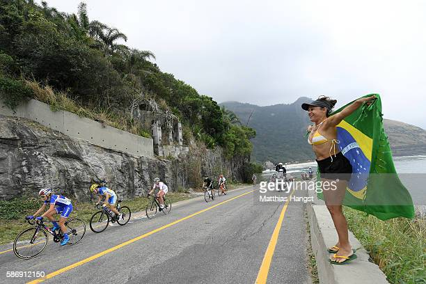 The Peloton including Linda Villumsen of New Zealand roll through Grumari during the Women's Road Race on Day 2 of the Rio 2016 Olympic Games at Fort...
