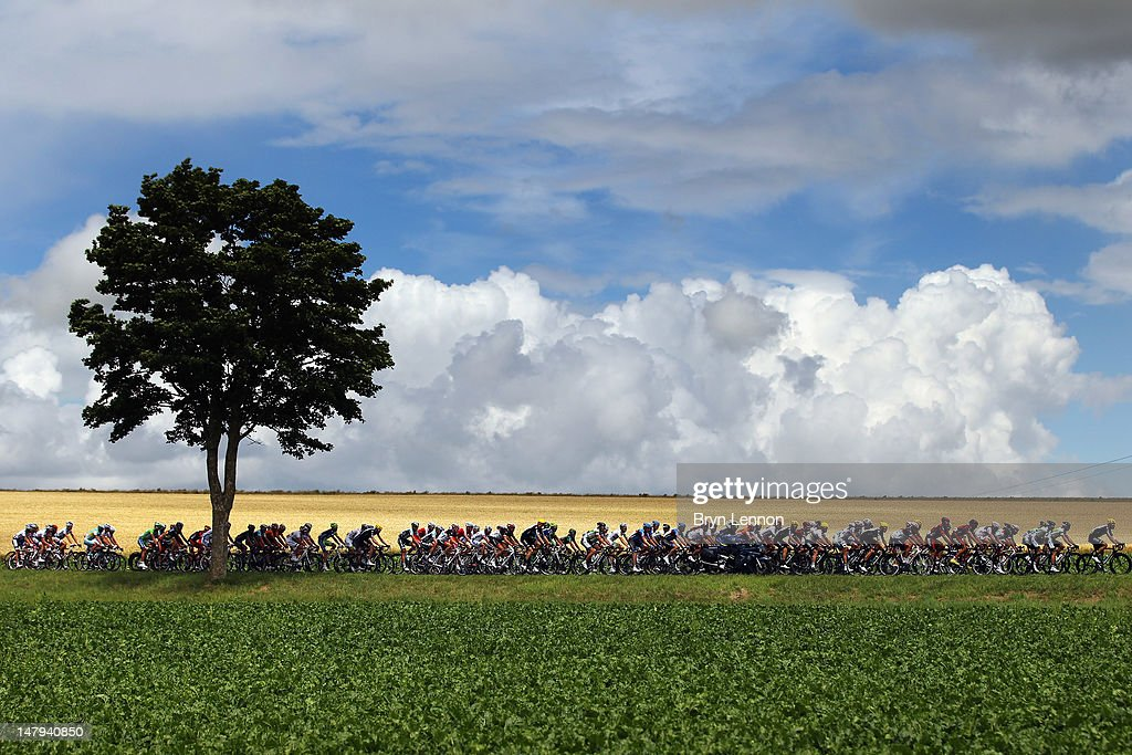 The peloton make their way through the French countryside on stage six of the 2012 Tour de France from Epernay to Metz on July 6, 2012 in Metz, France.