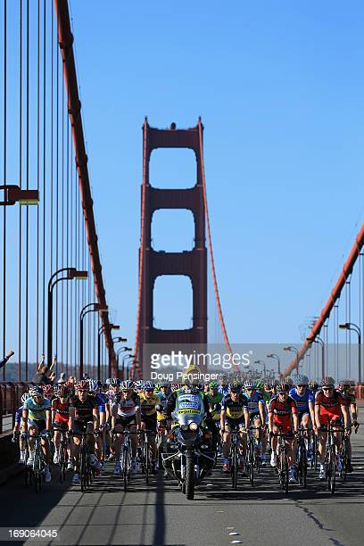 The peloton makes its way over the Golden Gate bridge as they leave the start of Stage Eight of the 2013 Amgen Tour of California from San Francisco...