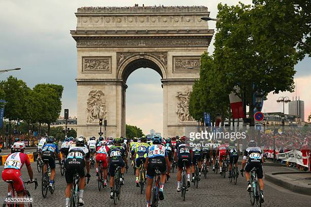 The peloton makes it's way through Paris during the twenty first stage of the 2014 Tour de France a 138km stage from Evry into the ChampsElysees on...