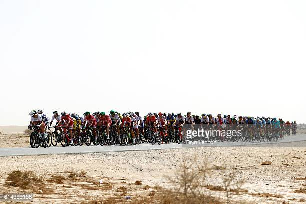 The peloton makes its way through the desert during the Elite Men's Road Race on day eight of the UCI Road World Championships on October 16 2016 in...
