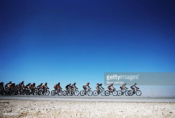 The peloton makes its' way through the Qatar desert on stage four of the Tour of Qatar from Camel Race Track to Al Khor Corniche on February 6, 2013...