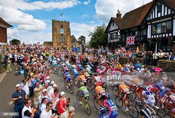 The peloton makes its way up the hill in the centre of the village of Goudhurst Kent during the Tour de France stage one from London to Canterbury on...