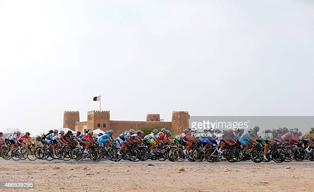 The peloton makes their way past the Al Zubara Fort during stage two of the 2014 Ladies Tour of Qatar from Al Zubara to Madinat Al Shamal on February...