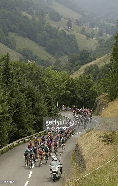The peloton of the yellow jersey climbs the Col de Mente during stage 14 of the Tour de France from Saint Girons to Loundenvielle-Le Louron on July...