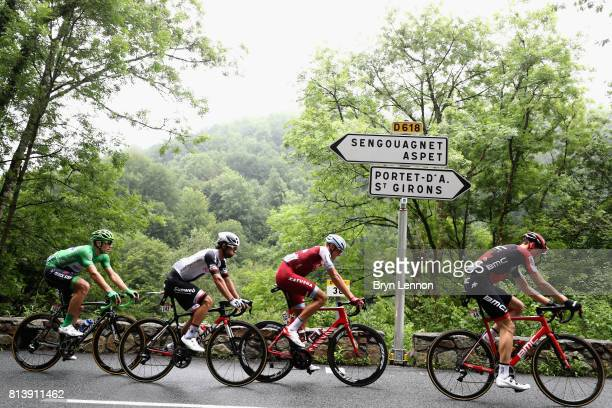 The peloton pass a road sign during stage 12 of the Le Tour de France 2017, a 214.5km stage from Pau to Peyragudes on July 13, 2017 in Pau, France.