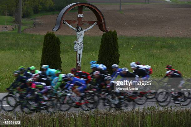 The peloton pass a statue of Jesus Christ during stage four of the Tour de Romandie from Fribourg to Fribourg on May 3 2014 in Fribourg Switzerland