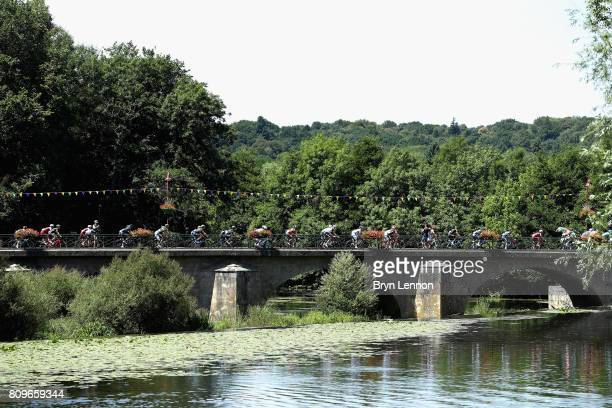 The peloton pass over a bridge during stage six of the 2017 Le Tour de France, a 216km road stage from Troyes to to Vesoul on July 6, 2017 in Troyes,...