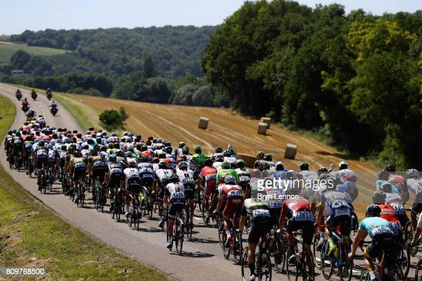 The peloton pass through during stage six of the 2017 Le Tour de France a 216km road stage from Troyes to to Vesoul on July 6 2017 in Troyes France